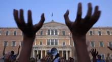 Protesters rally against austerity measures and corruption in Athens' Constitution square in June of 2011. (PASCAL ROSSIGNOL/REUTERS)