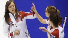 Canada's skip Rachel Homan (L) high five her teammate second Alison Kreviazuk during their draw against the United States at the World Women's Curling Championships in St. John, New Brunswick, March 17, 2014. (MATHIEU BELANGER/Reuters)