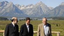 Federal Reserve Chairman Ben Bernanke, left, with New York Federal Reserve President Tim Geithner and Federal Reserve Vice Chairman Donald Kohn take a walk for a photo opportunity during the Annual Economic Symposium in Jackson Hole, Wyoming, on Aug. 22, 2008. (Bradly J. Boner/REUTERS)