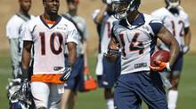 FILE - In this June 16, 2014 file photo, Denver Broncos wide receiver Emmanuel Sanders (10) calls out to wide receiver Cody Latimer (14) during an NFL football organized team activity at the team's training facility in Englewood, Colo. (Brennan Linsley/AP)