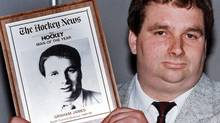 Convicted sex offender Graham James holds Hockey News man of the year award in Toronto in this June 8, 1989 file photo. (Bill Becker/THE CANADIAN PRESS)