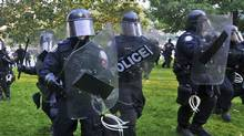 Police move in on protesters at Queen's Park during the G20 summit in Toronto. (Roger Hallett/The Globe and Mail/Roger Hallett/The Globe and Mail)