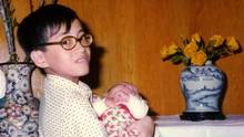 The Globe and Mail's Tu Thanh Ha at 11, holding his three-month-old sister, in a photo taken in the spring of 1975, just before the fall of Saigon.