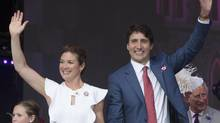 Prime Minister Justin Trudeau and his wife, Sophie Gregoire Trudeau, wave as they leave the stage in Ottawa on July 1, 2017. (Adrian Wyld/THE CANADIAN PRESS)