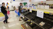 People buy the remaining stock at a Wonder Bread Hostess Bakery Outlet in Glendale, Calif., Nov. 16, 2012. (BRET HARTMAN/REUTERS)