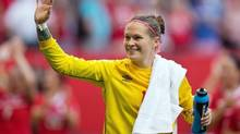 Canada goalkeeper Erin McLeod waves to fans after defeating Switzerland 1-0 in a FIFA Women's World Cup round of 16 soccer match in Vancouver on June 21, 2015. (Darryl Dyck/THE CANADIAN PRESS)