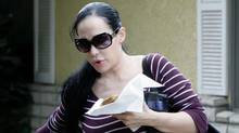 In this March 11, 2009 file photo, Nadya Suleman, the mother of octuplets, leaves her home in Whittier, Calif. (Nick Ut/AP)