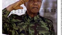 Nelson Mandela salutes the members of the ANC's armed wing at their 32nd anniversary celebrations. (Kevin Carter/Reuters)