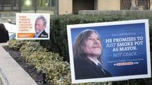 Election signs promote fictional Toronto mayoral candidates. (Tim McKenna/The Globe and Mail)