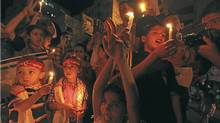 Palestinian children in Gaza City hold candles during a rally in solidarity with Palestinian prisoners held in Israeli jails, Oct. 13, 2011. (MOHAMMED SALEM/MOHAMMED SALEM/REUTERS)