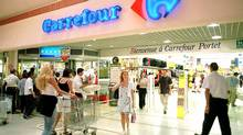 Carrefour, the world's second-biggest retailer behind U.S. group Wal-Mart, has been struggling for years, partly due to its reliance on hypermarkets, which have been losing out as time-pressed shoppers buy more goods locally and online. (CHRISTOPHE ENA/CHRISTOPHE ENA/AP)