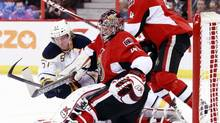 Buffalo Sabres' Tyler Myers (L) crashes into Ottawa Senators' goalie Craig Anderson as Senators' Chris Phillips looks on during the first period of their NHL game in Ottawa February 12, 2013. (BLAIR GABLE/REUTERS)