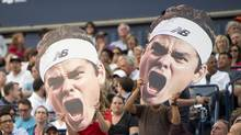 Fans of Milos Raonic, of Canada, hold posters during his third round win over Julien Benneteau, of France, in Rogers Cup tennis action in Toronto on Thursday August 7, 2014. (FRANK GUNN/THE CANADIAN PRESS)