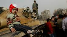 A child sits on a tank while a Egyptian soldiers stands by during a demonstration against President Hosni Mubarek in al-Tahir Square on Jan. 29, 2011 in Cairo, Egypt. (Chris Hondros/Chris Hondros/Getty Images)