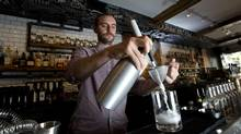 Taylor Corrigan, bar manager at Home of the Brave, uses carbonation to infuse vodka at his bar in Toronto. (Kevin Van Paassen/The Globe and Mail)