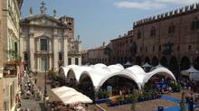 Piazza Sordello is seen in Mantova, Italy, the centre of the Mantova Literary Festival. The photo shows two of the canopies used by the author's festival: the onsite bookshop (left) and one of the stages for speakers. (Alan Bradley)