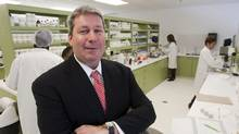 Valeant CEO Michael Pearson is seen in one of the company's laboratories. (Ryan Remiorz/Ryan Remiorz/THE CANADIAN PRESS)