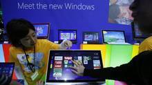 People try out Microsoft Corp's Windows 8 operating system at an event for its debut at the Akihabara electronics store district in Tokyo October 25, 2012. REUTERS/Toru Hanai (JAPAN - Tags: BUSINESS) (Toru Hanai/REUTERS)
