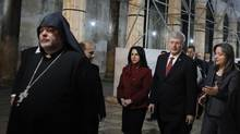 Canada's Prime Minister Stephen Harper (2nd R) is escorted by Bethlehem mayor Vera Baboun (3rd R) and Palestinian minister of tourism and antiquities Rula Ma'ayah (R) during his visit to the Church of Nativity, the site revered as the birthplace of Jesus, in the West Bank town of Bethlehem January 20, 2014. (AMMAR AWAD/REUTERS)