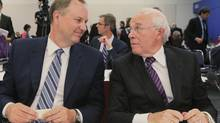 Bell Canada Enterprises president and chief executive George Cope, left, looks at Astral Media Inc. president and CEO Ian Greenberg as a break is called in the CRTC hearings in Montreal Sept. 10, 2012. (CHRISTINNE MUSCHI/REUTERS)
