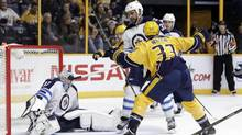 Nashville Predators left wing Colin Wilson (33) celebrates after scoring a goal against Winnipeg Jets goalie Connor Hellebuyck (37) during the second period of an NHL hockey game Friday, Nov. 25, 2016, in Nashville, Tenn. (Mark Humphrey/AP)