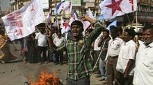 Activists in Hyderabad, India, shout slogans on Dec. 18, 2013, after burning an effigy of the U.S. to protest against the alleged mistreatment of Indian diplomat Devyani Khobragade. (Mahesh Kumar A./Associated Press)