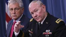 Chairman of the Joint Chiefs of Staff General Martin Dempsey (R) speaks next to U.S. Secretary of Defense Chuck Hagel during a media briefing at the Pentagon in Washington, July 3, 2014. (YURI GRIPAS/REUTERS)