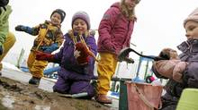 Jack Maxwell, 3; Grace Syms, 4; Lily Maxwell, 5; and Sydney Richardson, 3, dig up the playground at Spencer Smith Park in Bulrlington, Ont. (Fernando Morales/Fernando Morales/The Globe and M)