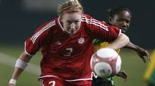 Canada's Melanie Booth chases down a pass in front of Jamaica's Audia Sullivan during their CONCACAF Women's Gold Cup soccer semi-final match in Carson, California, November 22, 2006. (Reuters)