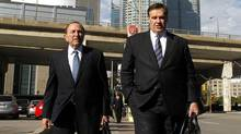 NHL commissioner Gary Bettman, left,  and Murray Edwards, co-owner of the Calgary Flames photographed while walking on Bay in the middle of the negotiations with the NHL aimed to end the lockout, Toronto October 18 2012. (Fernando Morales/The Globe and Mail)