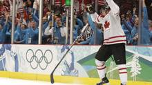 Team Canada's Sidney Crosby tosses his stick in the air while celebrating Canada's 3-2 gold medal overtime win over the United States at Hockey Place in Vancouver on February 28. (Photo by Peter Power / The Globe and Mail) (Peter Power)