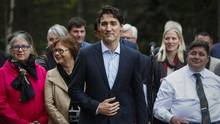Prime Minister Justin Trudeau speaks to the media with his cabinet at a Liberal Party cabinet retreat in Kananaskis, Alta., on Sunday. (Jeff McIntosh/THE CANADIAN PRESS)