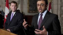 Foreign Affairs Minister John Baird listens as Foreign Minister of the United Arab Emirates His Highness Sheikh Abdullah bin Zayed al Nahyan responds to a question on Parliament Hill in Ottawa, Tuesday September 18, 2012. (Adrian Wyld/THE CANADIAN PRESS)