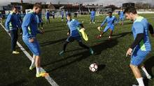 Sutton United players take part in a drill during a team training session and media day ahead of the F.A. Cup 5th round football match at The Borough Sports Ground in Sutton, sout-west London, on February 16, 2017. (ADRIAN DENNIS/AFP/Getty Images)