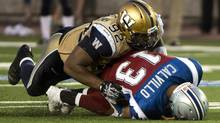 Winnipeg Blue Bombers defensive tackle Bryant Turner sacks Montreal Alouettes quarterback Anthony Calvillo during third quarter CFL football action in Montreal on July 4, 2013. (The Canadian Press)