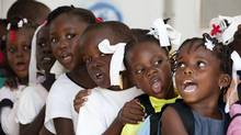 Children sing while they wait in line to wash their hands at Corail Cesselesse. (Deborah Baic/Deborah Baic/The Globe and Mail)
