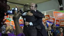 NDP candidate Paul Ferreira greets Leader Andrea Horwath at a campaign rally in the Toronto-area riding of York South-Weston on Sept. 7, 2011. (Anna Mehler Paperny/The Globe and Mail)
