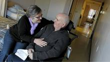 Jennifer Hall spends time with her husband Tom Hall , 61, as she does most afternoons, at Tyndall Nursing Home in Mississauga on Jan. 3, 2012. (Peter Power/Peter Power/The Globe and Mail)