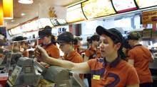 Service staff work at a McDonald's restaurant in Moscow in this February 1, 2010 file photo. (DENIS SINYAKOV/REUTERS)
