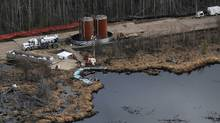 Cleanup under way at the Rainbow pipeline spill in northern Alberta. (Ian Jackson/THE CANADIAN PRESS)