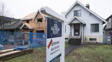The B.C. government has said surging real estate prices in the Lower Mainland are due in part to municipalities charging developers 'hidden costs,' such as public-art contributions, rezoning and demolition fees. (JONATHAN HAYWARD/THE CANADIAN PRESS)