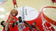 Jamaica's Adrian Uter, centre, defends against Canada's Brady Heslip, left, as Cory Joseph watches during their FIBA World Cup qualifying basketball game in Caracas, Venezuela, Friday, Aug. 30, 2013. (Fernando Llano/AP)