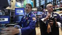 Traders work on the floor of the New York Stock Exchange, Oct. 1, 2012. (BRENDAN MCDERMID/REUTERS)