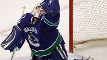 Vancouver Canucks' Andrew Raycroft makes a glove save during third period NHL action against the Anaheim Ducks in Vancouver, B.C., on Wednesday March 24, 2010. THE CANADIAN PRESS/Darryl Dyck (DARRYL DYCK)