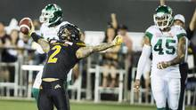 Hamilton Tiger-Cats slotback Chad Owens celebrates a touchdown against the Saskatchewan Roughriders in Hamilton on Aug. 20, 2016. (Peter Power/CP)