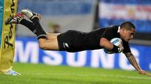 New Zealand All Blacks' Aaron Smith dives to score a try during their Rugby Championship match against Argentina Los Pumas in La Plata September 29, 2012. (MARCOS BRINDICCI/REUTERS)