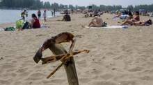In August 2009, Toronto set records with temperatures rising to 32 degrees celcius, with a humidex in the low forties. On Woodbine Beach in Toronto people were enjoying the heat. (Peter Power/Peter Power / The Globe and Mail)