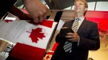 Chris Alexander, Canada's Minister of Citizenship and Immigration, welcomes 60 new citizens at a special citizenship ceremony in Toronto on Aug. 22, 2013. (PETER POWER/THE GLOBE AND MAIL)