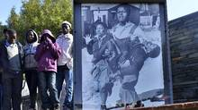 Children stand at the Hector Pieterson Memorial in Soweto, South Africa, in June, 2013. That year, a Canadian immigration investigator noticed Victor Vinnetou, the longest-serving detainee in Canadian immigration custody, looked remarkably similar to Mbuyisa Makhubu, the young man shown carrying the body of Pieterson in an iconic photo. (AFP/AFP/Getty Images)