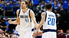 Dallas Mavericks forward Dirk Nowitzki (41) reacts after scoring during the game against the San Antonio Spurs in game six of the first round of the 2014 NBA Playoffs at American Airlines Center. Dallas won 113-111. (Kevin Jairaj/USA Today Sports)